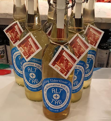 Six bottles of Sparkling Elderflower Drink arranged like skittles