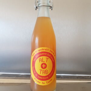 A photo of a bottle of Red Grapefruit Cordial with a read and yellow label